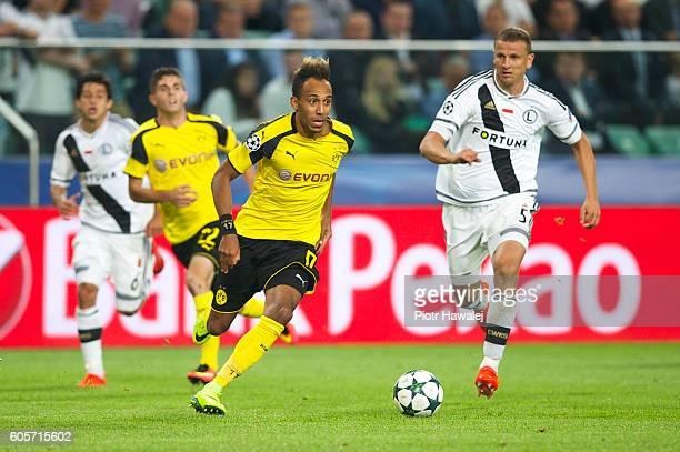 Maciej Dabrowski of Legia and PierreEmerick Aubameyang of Borussia in action during the UEFA Champions League match between Legia Warszawa and...