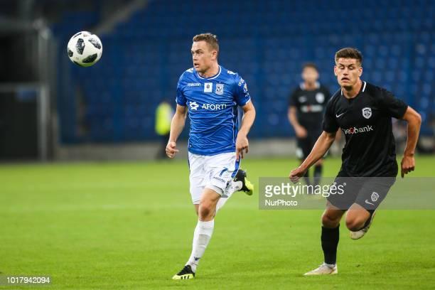 Maciej Gajos Jere Uronen during UEFA Europa League match between Lech Poznan v KRC Genk in Poznan Poland on August 16 2018