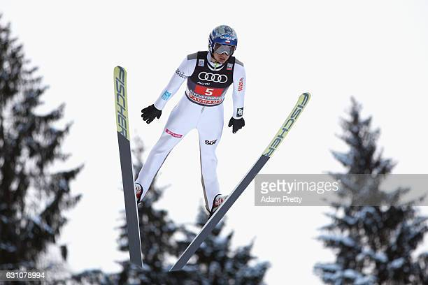 Maciej Kot of Poland competes at the trail round on Day 2 of the 65th Four Hills Tournament ski jumping event at PaulAusserleitnerSchanze on January...