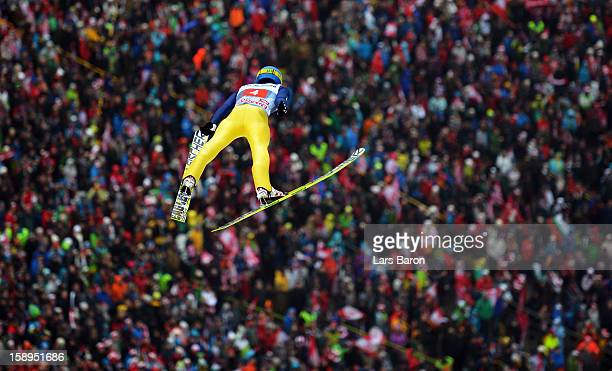 Maciej Kot of Poland competes during the first round for the FIS Ski Jumping World Cup event of the 61st Four Hills ski jumping tournament at...