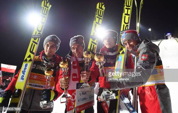 Maciej Kot Piotr Zyla Dawid Kubacki and Kamil Stoch of Poland after the nordic ski jumping team discipline during the World Cup in Willingen Germany...