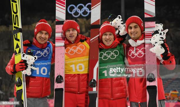 Maciej Kot Stefan Hula Dawid Kubacki and Kamil Stoch of Poland celebrate their bronze medal during the Ski Jumping Men's Team Large Hill on day 10 of...