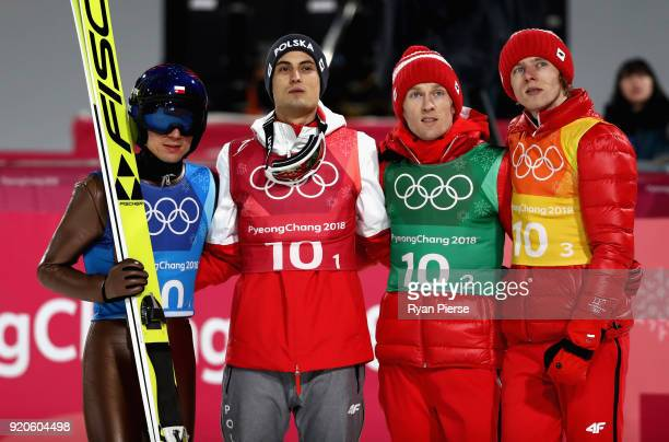 Maciej Kot Stefan Hula Dawid Kubacki and Kamil Stoch of Poland watch on during the Ski Jumping Men's Team Large Hill on day 10 of the PyeongChang...