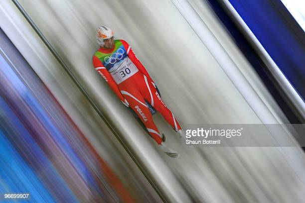 Maciej Kurowski of Poland competes during the final run of the men's luge singles final on day 3 of the 2010 Winter Olympics at Whistler Sliding...