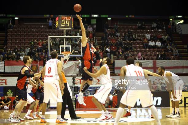 Maciej Lampe #30 of Caja Laboral Vitoria competes with Ioannis Bourousis #15 of EA7 Emporio Armani Milan during the tipoff of the 20122013 Turkish...