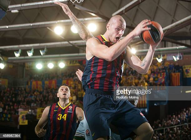 Maciej Lampe #30 of FC Barcelona captures a rebound during the 20142015 Turkish Airlines Euroleague Basketball Regular Season Date 5 game between FC...