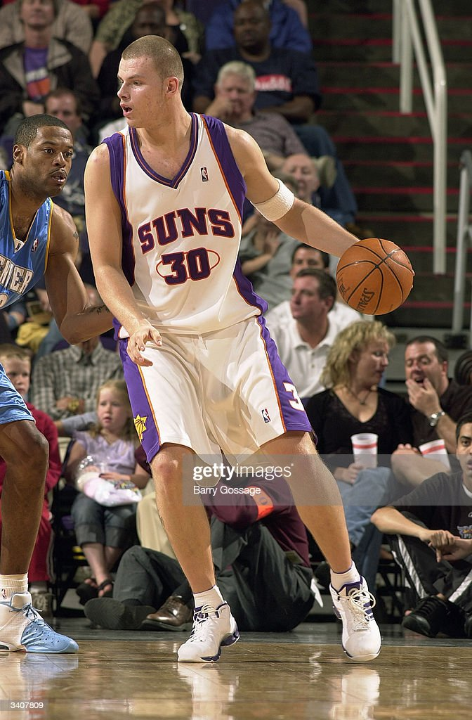 Maciej Lampe Of The Phoenix Suns Is Defended By Rodney White Of The