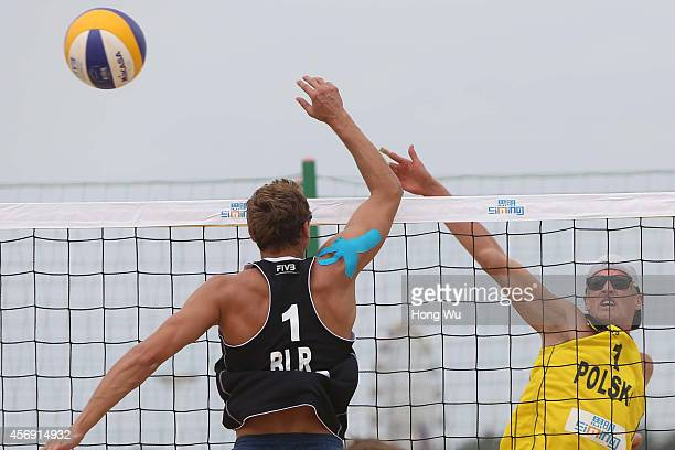 Maciej Rudol of Poland in action for the ball on Day 3 at the 2014 FIVB Beach Volleyball World Tour Xiamen Open men Main draw match on October 9 2014...