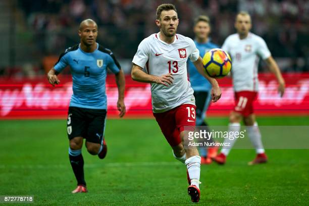 Maciej Rybus from Poland fights for the ball with while Poland v Uruguay International Friendly soccer match at National Stadium on November 10 2017...