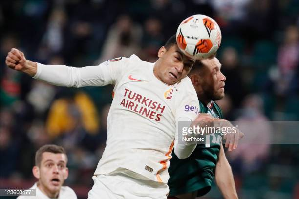 Maciej Rybus of Lokomotiv Moscow and Mostafa Mohamed of Galatasaray vie for a header during the UEFA Europa League Group E football match between FC...
