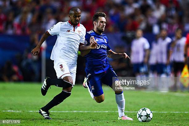 Maciej Rybus of Olympique Lyonnais competes for the ball with Mariano Ferreira of Sevilla FC during the UEFA Champions League Group H match between...