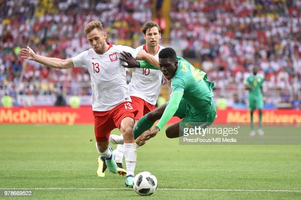 Maciej Rybus of Poland competes with Ismaila Sarr of Senegal during the 2018 FIFA World Cup Russia group H match between Poland and Senegal at...