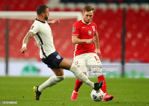 Maciej Rybus of Poland is challenged by Kyle Walker of England during the FIFA World Cup 2022 Qatar qualifying match between England and Poland on...