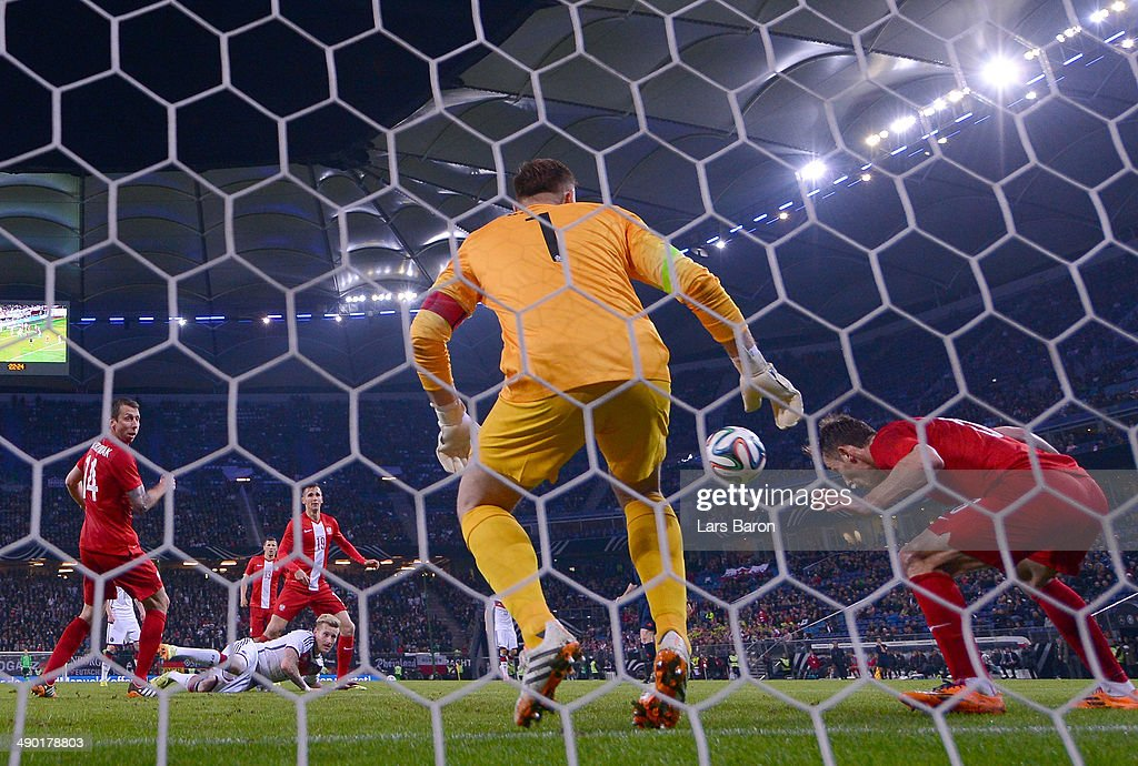 Maciej Rybus of Poland saves a shot of Andre Hahn of Germany on the goalline during the International Friendly match between Germany and Poland at Imtech Arena on May 13, 2014 in Hamburg, Germany.
