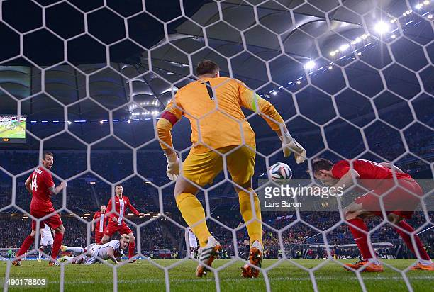 Maciej Rybus of Poland saves a shot of Andre Hahn of Germany on the goalline during the International Friendly match between Germany and Poland at...