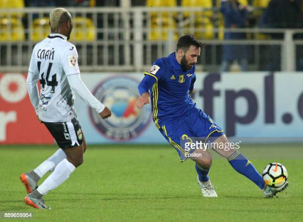 Maciej Wilusz of FC Rostov RostovonDon vies for the ball with Sly of FC Ufa during the Russian Premier League match between FC Rostov RostovonDon v...