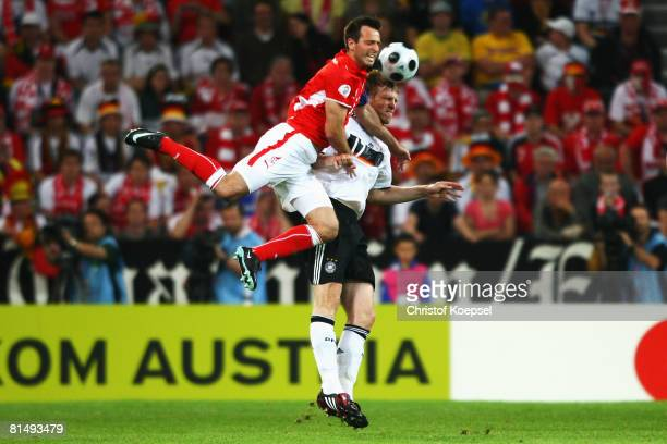 Maciej Zurawski of Poland jumps over Per Mertesacker of Germany to control the ball during the UEFA EURO 2008 Group B match between Germany and...