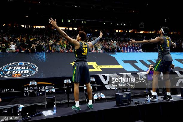 MaCio Teague and Flo Thamba of the Baylor Bears celebrate after The Baylor Bears defeated the Gonzaga Bulldogs in the National Championship game of...
