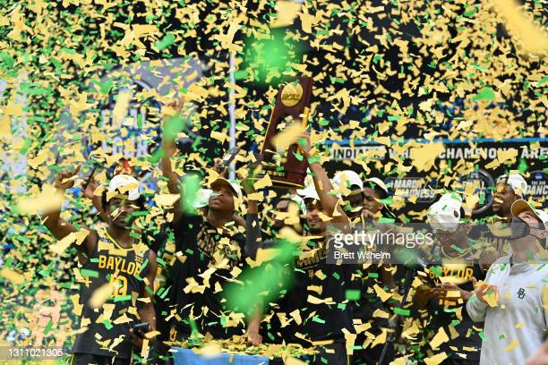 MaCio Teague and Mark Vital of the Baylor Bears celebrate with the trophy after defeating the Gonzaga Bulldogs in the National Championship game of...