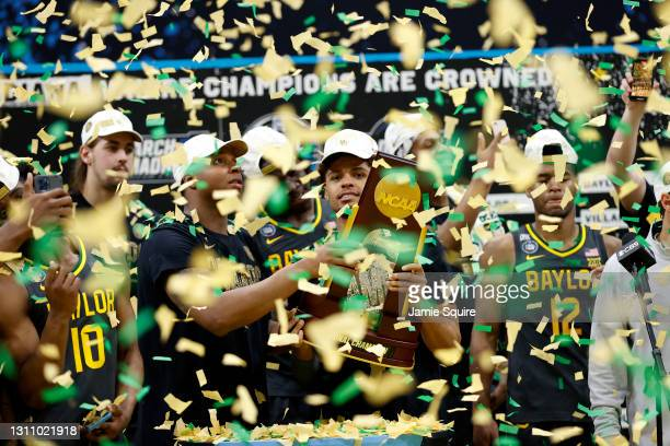 MaCio Teague and Mark Vital of the Baylor Bears hold up the trophy after defeating the Gonzaga Bulldogs 86-70 in the National Championship game of...