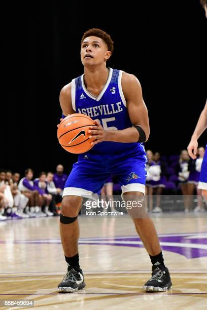 MaCio Teague guard UNC Asheville Bulldogs attempts a free throw against the Furman University Paladins Tuesday December 5 at Timmons Arena in...