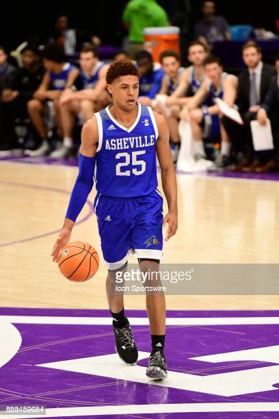 MaCio Teague guard UNC Asheville Bulldogs dribbles the basketball downcourt against the Furman University Paladins Tuesday December 5 at Timmons...