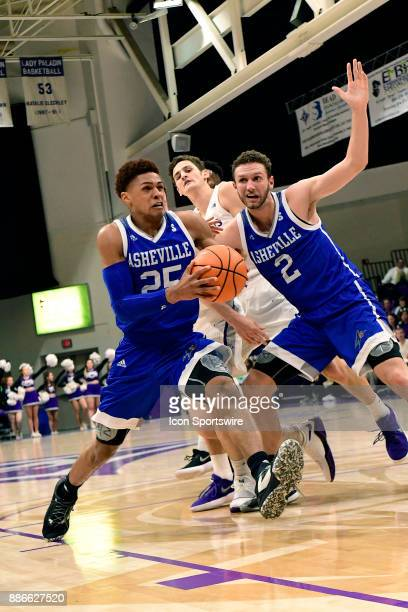 MaCio Teague guard UNC Asheville Bulldogs drives to the basket against the Furman University Paladins Tuesday December 5 at Timmons Arena in...