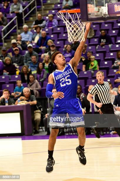 MaCio Teague guard UNC Asheville Bulldogs leads all scorers at the haf in the game against the Furman University Paladins Tuesday December 5 at...