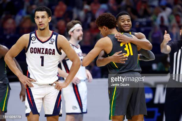 MaCio Teague hugs Jared Butler of the Baylor Bears during the National Championship game of the 2021 NCAA Men's Basketball Tournament against the...