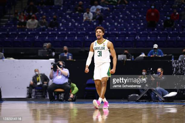 MaCio Teague of the Baylor Bears celebrates a basket late in the game against the Baylor Bears in the Elite Eight round of the 2021 NCAA Division I...