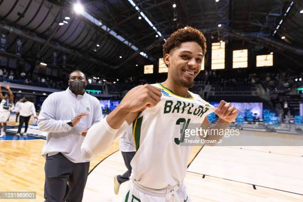 MaCio Teague of the Baylor Bears celebrates after defeating the Villanova Wildcats in the Sweet Sixteen round of the 2021 NCAA Division I Mens...