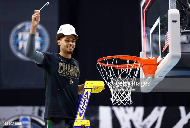 MaCio Teague of the Baylor Bears cuts the net after defeating the Gonzaga Bulldogs 86-70 in the National Championship game of the 2021 NCAA Men's...