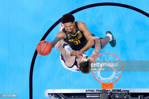 MaCio Teague of the Baylor Bears goes up for a basket against Drew Timme of the Gonzaga Bulldogs in the National Championship game of the 2021 NCAA...