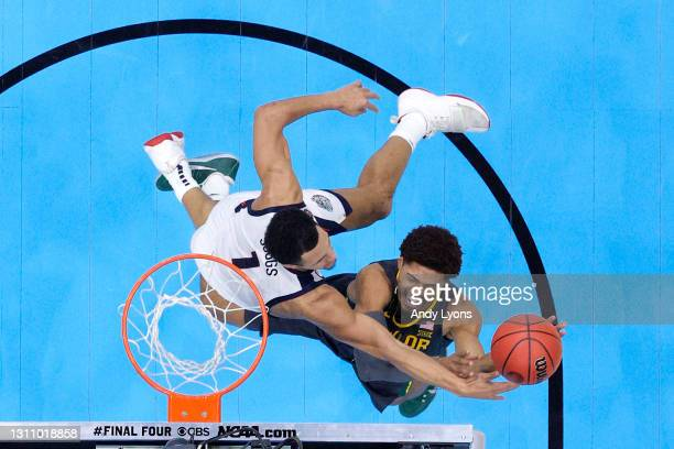 MaCio Teague of the Baylor Bears goes up for a basket against Jalen Suggs of the Gonzaga Bulldogs in the National Championship game of the 2021 NCAA...