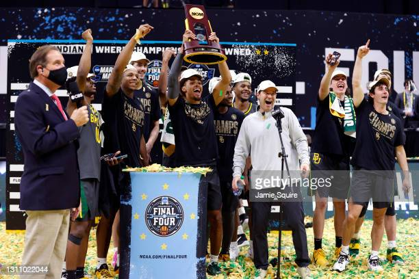 MaCio Teague of the Baylor Bears holds up the trophy after defeating the Gonzaga Bulldogs 86-70 in the National Championship game of the 2021 NCAA...