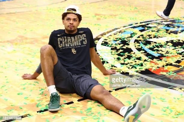 MaCio Teague of the Baylor Bears lays on the court after defeating the Gonzaga Bulldogs in the National Championship game of the 2021 NCAA Men's...