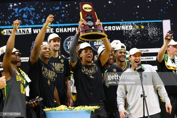 MaCio Teague of the Baylor Bears raises the trophy after defeating the Gonzaga Bulldogs in the National Championship game of the 2021 NCAA Men's...