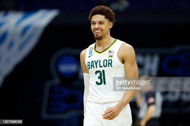 MaCio Teague of the Baylor Bears reacts after a play against the Hartford Hawks in the first round game of the 2021 NCAA Men's Basketball Tournament...