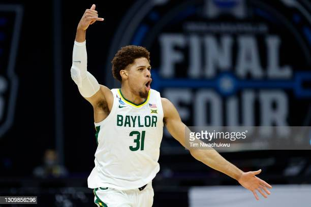MaCio Teague of the Baylor Bears reacts after making a three point basket against the Arkansas Razorbacks during the second half in the Elite Eight...