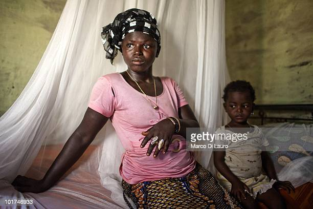 Macire Camara and her daughter Aissata who had malaria but survive after treatment at the local hospital are seen during British Actor and UNICEF...