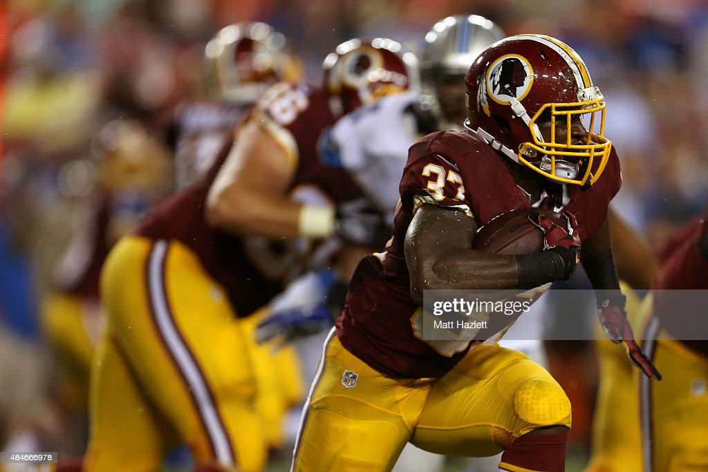 Mack Brown #37 of the Washington Redskins carries the ball during a preseason game against the Detroit Lions at FedEx Field on August 20, 2015 in Landover, Maryland.