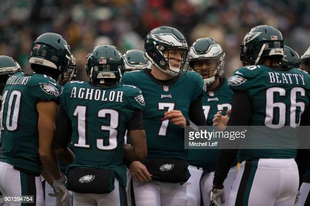 Mack Hollins Nelson Agholor Nate Sudfeld and Will Beatty of the Philadelphia Eagles huddle against the Dallas Cowboys at Lincoln Financial Field on...