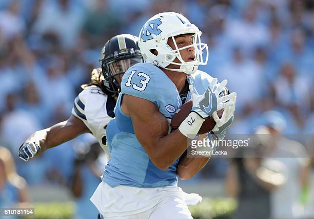 Mack Hollins of the North Carolina Tar Heels catches a touchdown pass against the Pittsburgh Panthers during their game at Kenan Stadium on September...