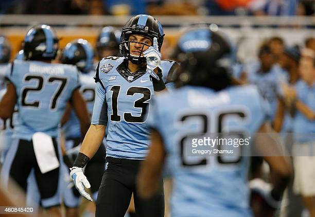 Mack Hollins of the North Carolina Tar Heels celebrates a first quarter blocked punt while playgoing the Rutgers Scarlet Knights during the Quick...