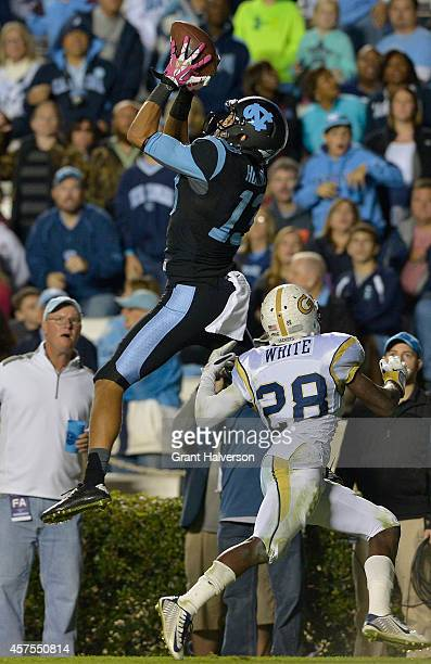 Mack Hollins of the North Carolina Tar Heels makes a catch against DJ White of the Georgia Tech Yellow Jackets during their game at Kenan Stadium on...