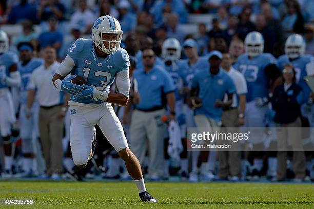 Mack Hollins of the North Carolina Tar Heels makes a catch against the Virginia Cavaliers during their game at Kenan Stadium on October 24 2015 in...