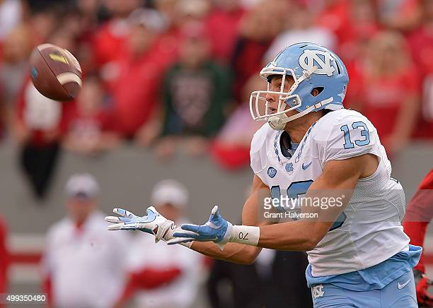 Mack Hollins of the North Carolina Tar Heels makes a catch against the North Carolina State Wolfpack during their game at CarterFinley Stadium on...