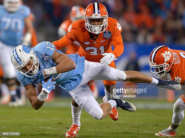 Mack Hollins of the North Carolina Tar Heels makes a catch against Ryan Carter of the Clemson Tigers during the Atlantic Coast Conference Football...
