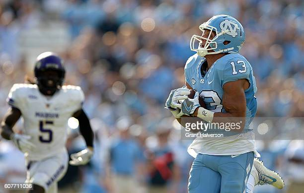 Mack Hollins of the North Carolina Tar Heels makes a touchdown catch against the James Madison Dukes during the game at Kenan Stadium on September 17...