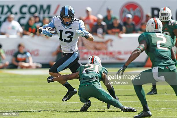 Mack Hollins of the North Carolina Tar Heels runs with the ball against the Miami Hurricanes on November 1 2014 at Sun Life Stadium in Miami Gardens...